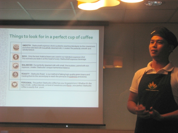 Dwight, Starbucks Coffee Ambassador, teaching the attendees what to look for in a perfect coffee cup.