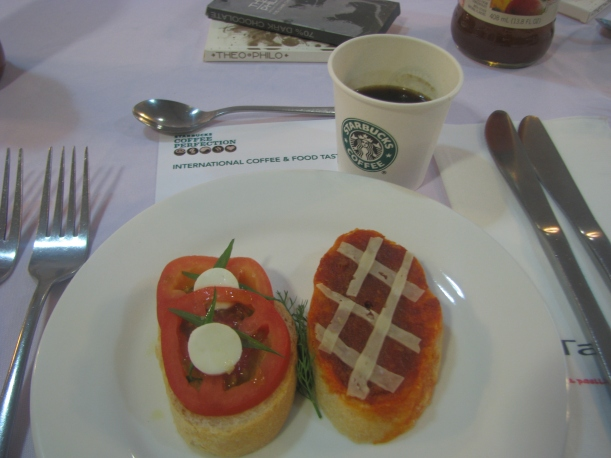 Bruschetta on tomato salad with goat cheese and herb; chorizo spread with manchego cheese; and Starbucks Tribute Blend.