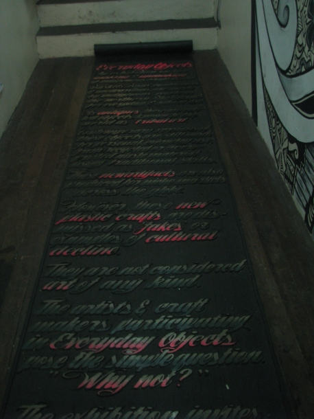 Carpet made with rubber, with a prose etched on it.