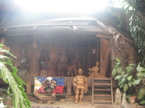 Wooden sculptures and a kubo.