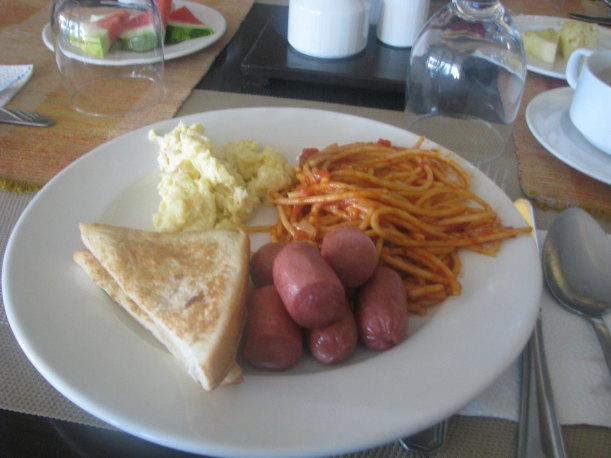 Pasta, French Toast, hotdogs, scrambled eggs. Plus choice of coffee or tea. Not in photo: corned beef, and plate of pineapple and watermelon.