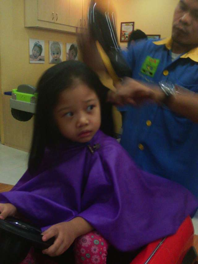 Blow-dry time. It was like Kuya Hairdresser was yanking off her head that time. Poor mini-me.