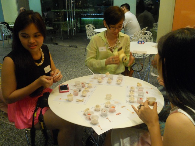 Bloggers putting toppings on their Peanut Butter Pinkberry